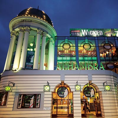 The outside of the Alhambra Theatre, Bradford at night