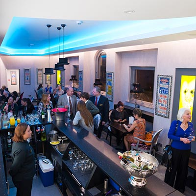 Customers enjoying drinks in the Laidler VIP Lounge at the Alhambra Theatre