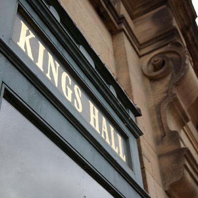 Close up of the sign for King's Hall Ilkley on the outside of the venue