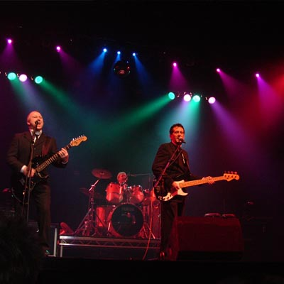 A band performing on stage at King's Hall